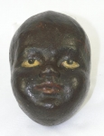 Click to view Black Face of Child Door Stop photos